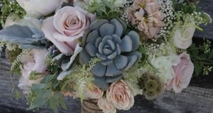 A shabby chic bridal bouquet featuring succulents, dusty pink roses and peonies