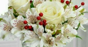 This pretty floral arrangement is appropriate from December thru Valentine's...