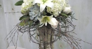 Blush pink and ivory tall centerpieces with roses, lilies, hydrangea and succule...